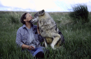Dr. Susan Eirich with wolf at EarthFire Sanctuary
