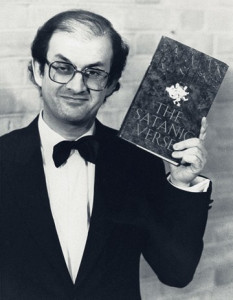 Salman Rushdie and a copy of the offending text, London, 1989. From PA Photos/Landov.