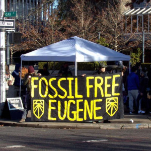 """A banner reading """"Fossil Free Eugene"""""""