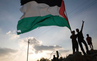 Children silhouetted holding Palestinian flag (image from http://www.tadamon.ca))